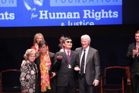 (Left to right) Annette Tillemann,Tom Lantos's widow,Yuan Weijing,Chen Guangchen's wife and activist,Chen Guangcheng,Chinese activist,and actor Richard Gere stand at the end of the Tom Lantos Human Rights Prize award ceremony held Tuesday at the Capitol. SHFWire photo by Jasmine Aguilera
