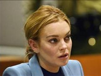 Actress Lindsay Lohan pleads not guilty to charges of crashing her car into the back of a garbage truck