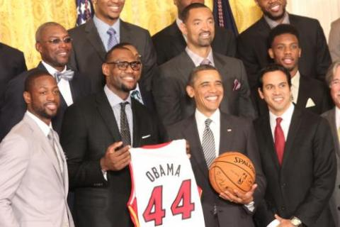 President Barack Obama stands with Miami Heat players after receiving a No. 44 jersey from them at the White House. SHFWire photo by EddieAmeh