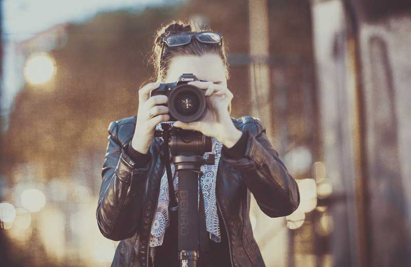 Woman taking photo. Image by Pexels from Pixabay